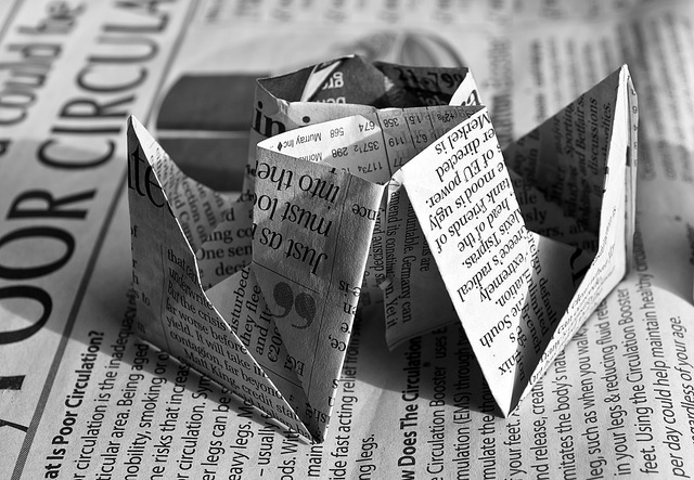 Cleverly folded newspaper. Asheville Public Relations.
